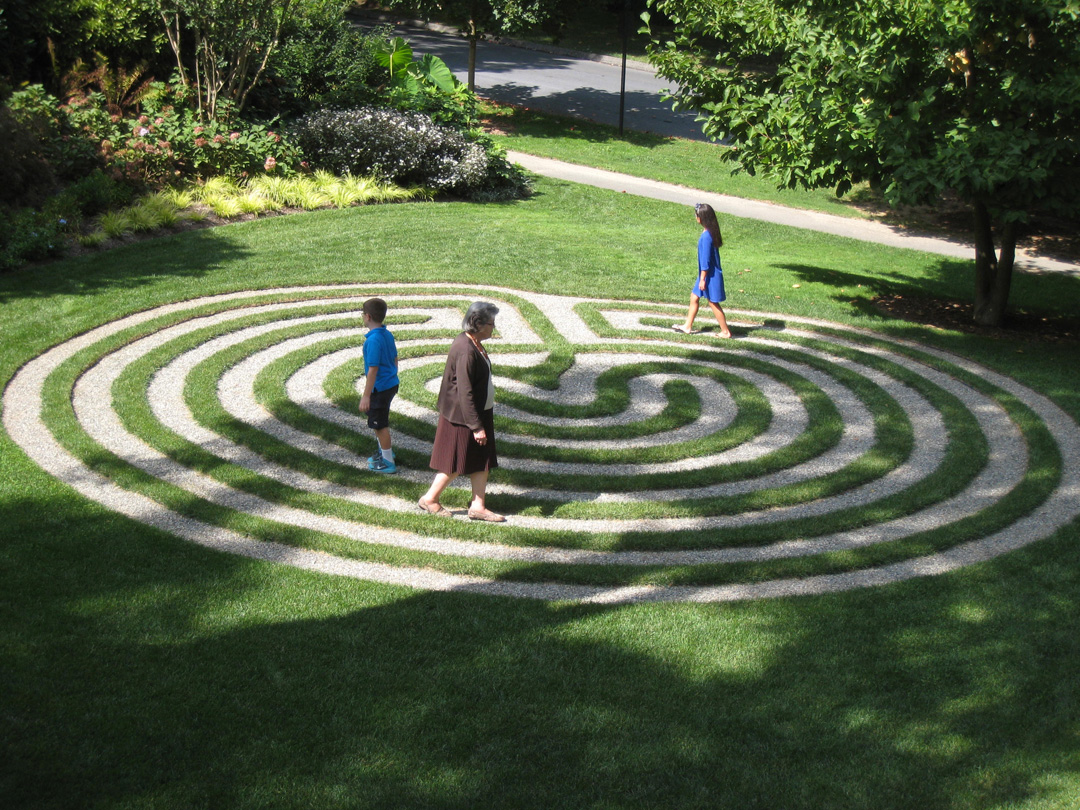 Kiera and Brock Green and their grandmother, Marian Green, enjoy a walk around the labyrinth at Vickie Baily's house in Garrett Park, Maryland.