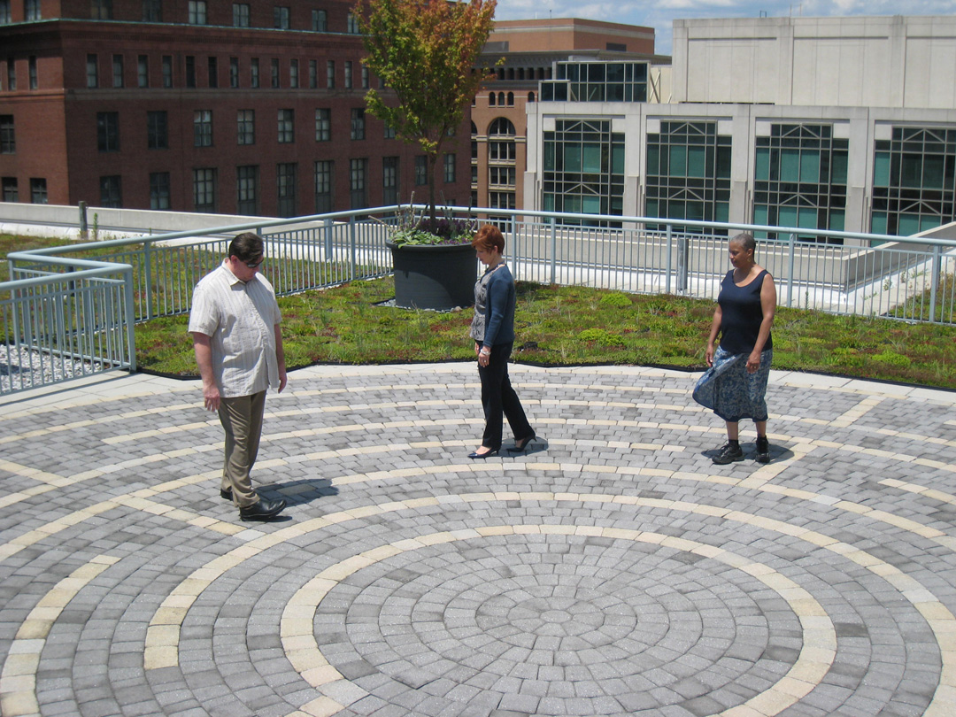 John Flanagan, Susan Hillson and Rozella Cribbs-Grant walk the labyrinth on the American Psychological Association building's green roof.